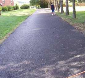 Homeowner inspecting paving job after completion