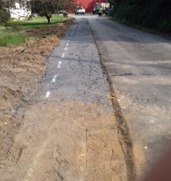 Country road with major damage before being paved