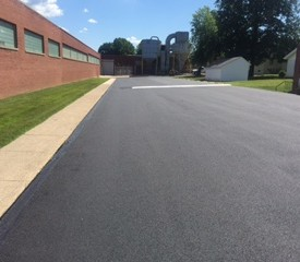 Freshly paved parking lot at factory