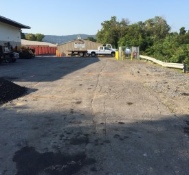 Crumbling and cracked parking lot behind business