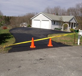 Driveway leading to garage roped off after being paved