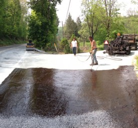 Crew adding final touches on tar chip