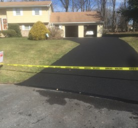 Driveway roped off with caution tape after paving
