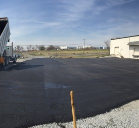Large commercial parking lot for warehouse being paved