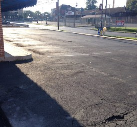 Parking lot with potholes and cracks