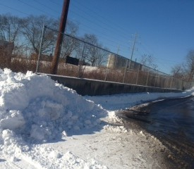 Snow packed up after plowing parking lot