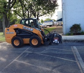 Skid steer used to remove top layer of old parking lot