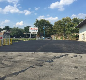 Richard Diehl Paving crew at parking lot at Action Rental