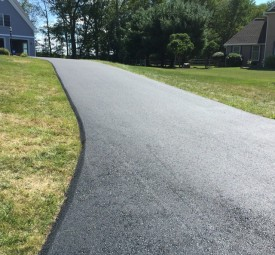 Closeup of driveway after being paved