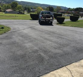 Faded driveway before being paved
