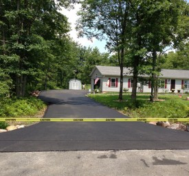 Driveway sealed off after being paved