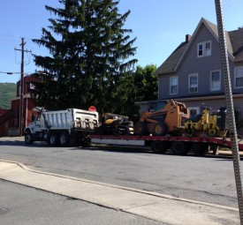 Richard Diehl paving truck towing equipment to job site