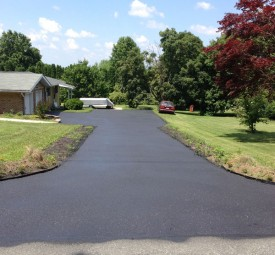 driveway after being paved up to garage